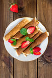 Pancakes with strawberry on plate. vertical royalty free stock photography