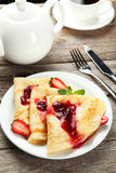 Pancakes with strawberry on plate on white wooden backgound. Royalty Free Stock Photos