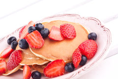 Pancakes with strawbery and blueberry Royalty Free Stock Photography