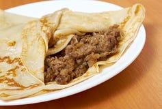 Pancakes stuffed beef. Stock Photos