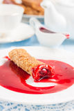 Pancakes stuffed with cherries and cherry sauce Stock Photography