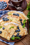 Pancakes stuffed with cottage cheese with blueberry and cup of coffee. Stock Image
