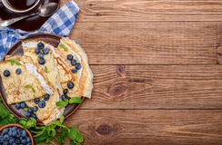 Pancakes stuffed with cottage cheese with blueberry and cup of coffee. Royalty Free Stock Image