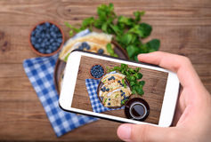 Pancakes stuffed with cottage cheese with blueberry and cup of coffee. Breakfast. Royalty Free Stock Photo