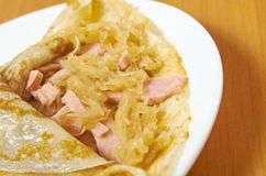 Pancakes stuffed ham and cabbage stew Royalty Free Stock Photo