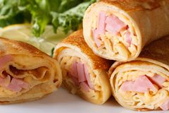 Pancakes stuffed with ham and cheese horizontal macro Stock Photos