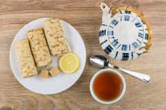 Pancakes with stuffed, lemon, sugar, teapot, teaspoon  and tea Stock Image
