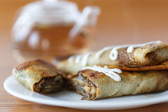 Pancakes stuffed with mushrooms and cabbage. With sour cream Royalty Free Stock Image