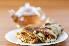 Pancakes stuffed with mushrooms and cabbage Stock Photo