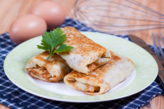 Pancakes with stuffed on a plate. With parsley Stock Photography