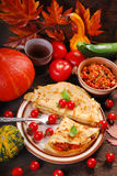 Pancakes stuffed with pumpkin,zucchini and minced meat Royalty Free Stock Image