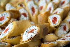 Pancakes stuffed white cheese, dill and red fish _ Royalty Free Stock Photography