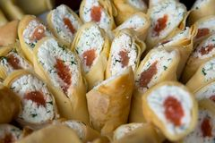 Pancakes stuffed cheese, dill and red fish Royalty Free Stock Images
