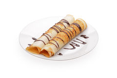 Pancakes with stuffing. And chocolate syrup Stock Photography