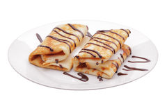 Pancakes with stuffing. And chocolate syrup Stock Images