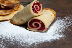 Pancakes. Sugared pancakes with cherry jam stock images