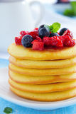 Pancakes with summer berries:. Strawberries, blueberries Stock Photo