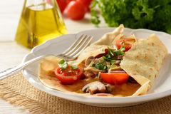 Pancakes sutffed with ham, cheese, tomatoes and mushrooms. Stock Image