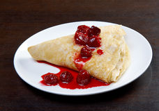 Pancakes with sweet cherry confiture Stock Photo