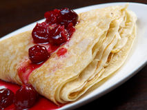 Pancakes with sweet cherry confiture Royalty Free Stock Images