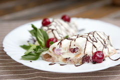 Pancakes with sweet cherry cream and mint Stock Photography