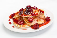 Pancakes with sweet cherry sauce Royalty Free Stock Photography