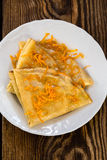 Pancakes with sweet citrus  sauce, crepes Suzette Royalty Free Stock Photos