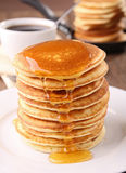 Pancakes and syrup. Plate of pancakes stack with syrup Stock Photos