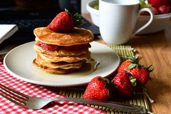 Pancakes in syrup for breakfast ,time to eat. We love to eat pancakes in syrup easy to eat and yummy Royalty Free Stock Images