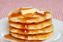 Pancakes with syrup and butter. Close up of pancakes with syrup and butter on a plate Stock Photo