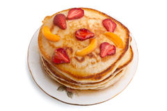 Pancakes with syrup and fruit on a plate Stock Photos
