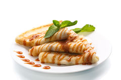 Pancakes with syrup and mint Stock Photo