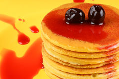 Pancakes with syrup and sour cherries Stock Images