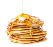 Pancakes in syrup. Stack of Small pancakes in syrup on white background Stock Photo