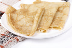 Pancakes. Tradionny Russian pancakes on a plate, it is isolated on a white background Royalty Free Stock Photography