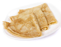 Pancakes. Tradionny Russian pancakes on a plate, it is isolated on a white background Royalty Free Stock Image