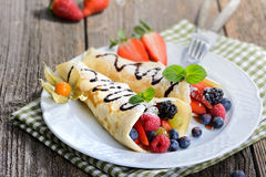 Pancakes. Two homemade pancakes stuffed with mixed berries Stock Photography
