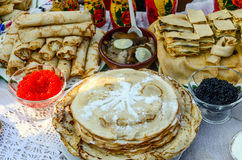 Pancakes with various fillings, with caviar, mushrooms Stock Photography