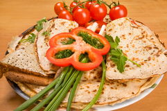 Pancakes and vegetables. Royalty Free Stock Photos