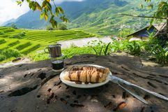 Pancakes and Vietnamese style coffee with picturesque background Royalty Free Stock Images