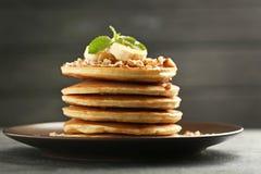 Pancakes with walnuts and bananas Royalty Free Stock Photo