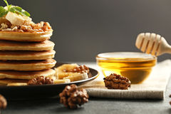 Pancakes with walnuts and bananas Stock Photos