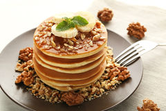 Pancakes with walnuts and bananas Stock Image