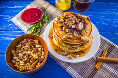 Pancakes with walnuts and maple syrup for breakfast. Close-up. Pancakes with walnuts and maple syrup for breakfast stock photo