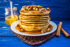 Pancakes with walnuts and maple syrup for breakfast. Close-up. Pancakes with walnuts and maple syrup for breakfast stock images