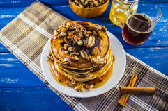 Pancakes with walnuts and maple syrup for breakfast. Close-up. Pancakes with walnuts and maple syrup for breakfast royalty free stock photography