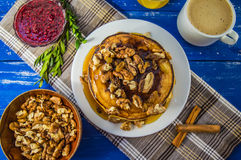 Pancakes with walnuts and maple syrup for breakfast. Close-up. Pancakes with walnuts and maple syrup for breakfast royalty free stock images