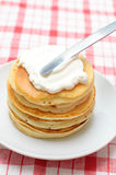 Pancakes with whipped cream Royalty Free Stock Image