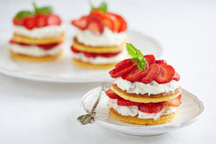 Pancakes with whipped cream and strawberries Royalty Free Stock Image