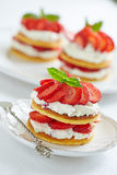 Pancakes with whipped cream and strawberries Stock Photography